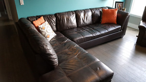 Brown leather sectional w/ fold out bed