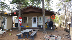 For rent cozy cabin close to beach at Candle Lake