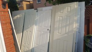 Over a dozen Brand NEW and used Wood doors for sale $ 20 - $50