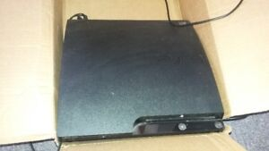 PlayStation 3 with 2 controllers and 5 games