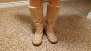 Beige moccasin boots.  Comfy inside. Size 7