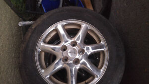 Set of 4, 7 spoke STS Polished Aluminum Rims with Rubber 5x ?