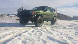 Mean green lifted daily driven off roading machine sell/trade