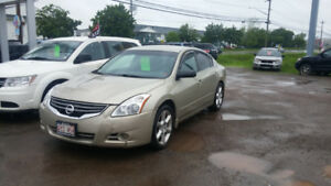 2010 Nissan Altima 2.5s auto loaded looks and rin a very well