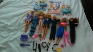Barbie - 7 dolls, clothes, accessories, carrying case o.b.o.