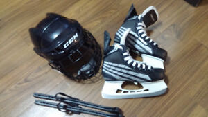 Size 4 Bauer skates and xs helmet
