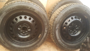 Studded snow tires and rims $850 obo