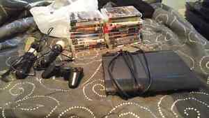 PS3 with 23 games 1 controller 2 move sticks and camera.