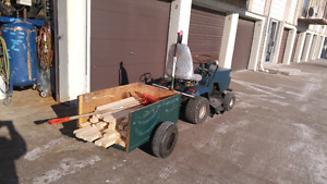 Riding lawn mower with utility cart