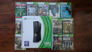 Xbox 360 like new in box, 11 games, no controllers