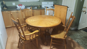 Solid oak dining table and chairs