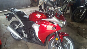 2012 Honda CBR 250R with leather jacket