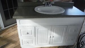 """48"""" white vanity with sink and counter."""