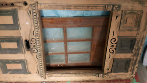 Large antique wood door with beautiful detail