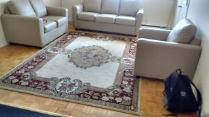 Canadian made couches (leather) plus turkish carpet