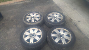 Volkswagon passat snow tires and rims 100 $ as is