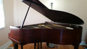 Kranich and Bach baby grand piano