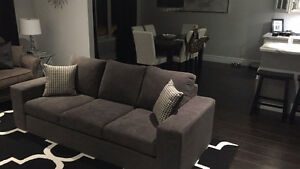 Brand new grey couch with pillows