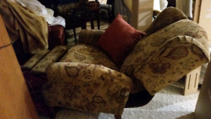 2 recliner chairs brownish in color