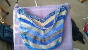 Hand knitted shopping or hand bags.