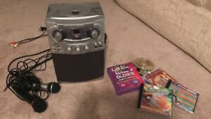 Kareoke machine, 2 microphones and sing along tapes