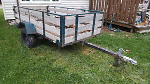 5 x 10 TILTING Utility trailer. New jack, tongue, and boards