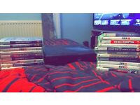 Xbox 360 slim model, works perfect, big bundle of games also