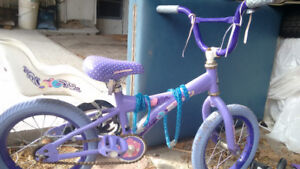 Old kid's bike with seat for doll