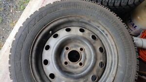 Four Snow Tires on Steel Rims - Size 185/65R14
