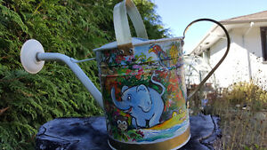 Hand painted metal watering can - slightly used