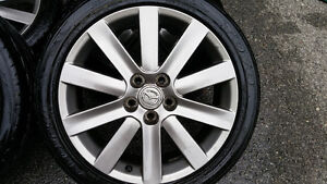 Mazda Gunmetal Mags and Tire 214-45-18 Bolt pattern 5x114.3