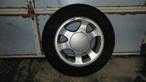 4 Mustang rims and winter tires