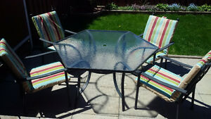 Hexagonal metal patio table with 4 chairs and cushions
