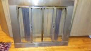 fire place glass door with iron screen