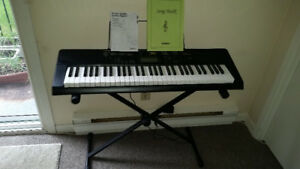 CASIO keyboard with stand, cables and handbook