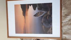 Lake and canoe sunset framed print