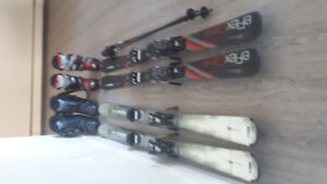 2 pairs skis  with  boots 10/1/2 and 8/1/2