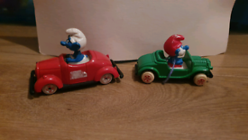 Rare Vintage 1980s Smurf in red Car By ESCI & papa smurf in green by e