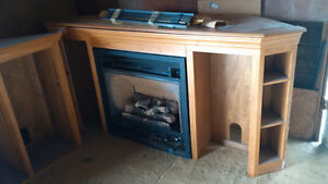 Gas Fireplace complete with oak mantle and TV wall unit
