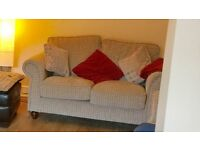 Pair of matching two seater sofas