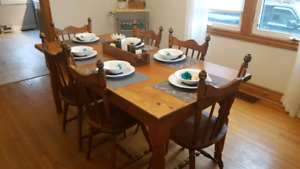 Rustic wood harvest table and chairs