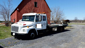 1996 Freightliner FL 60 Flatbed towTruck trade for heavy wrecker