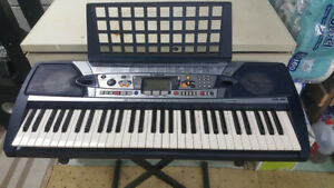 Yamaha PSR-280 Portable Keyboard with Dynamic 2-Way Speakers. In