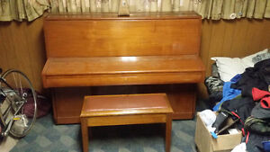 Piano upright,bench with storage,music sheets,timer thing