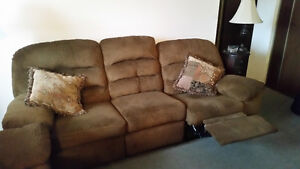 Couch and matching love seat - both recline. Great shape!