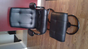 Swivel chair with footstool