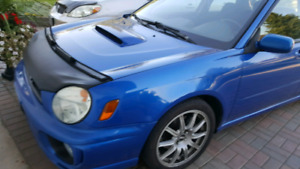 2002 wrx wagon. Excellent records and history. No quater rust