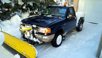 1997 Ford Ranger 4x4 with a fisher plow