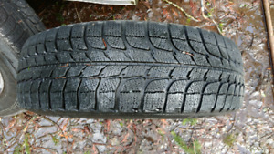 """2 wheels with michelin winter tires 14"""". Bolt pattern- 4 studs"""