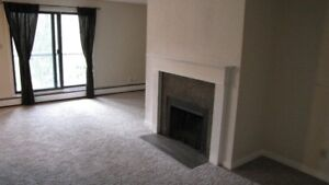 One bdrm apartment with a den, covered pkg & much more